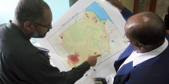 Officials look at the newly unveiled map of Sudan after separation