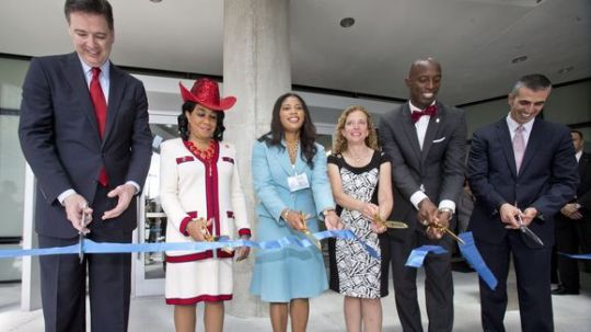 Congresswoman Frederica Wilson at 2015 dedication of FBI Building (FBI Director Comey is 1st Left)